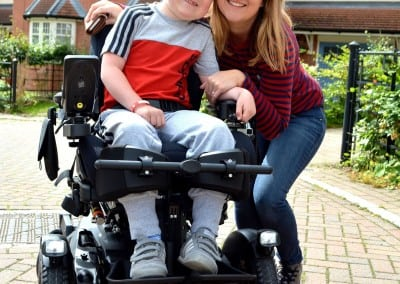 Oliver Harness and Mum Emma taking delivery of his new wheelchair